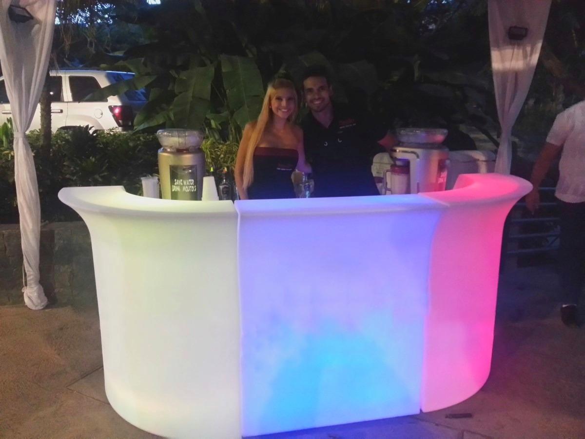 3 glow drinks serving bar