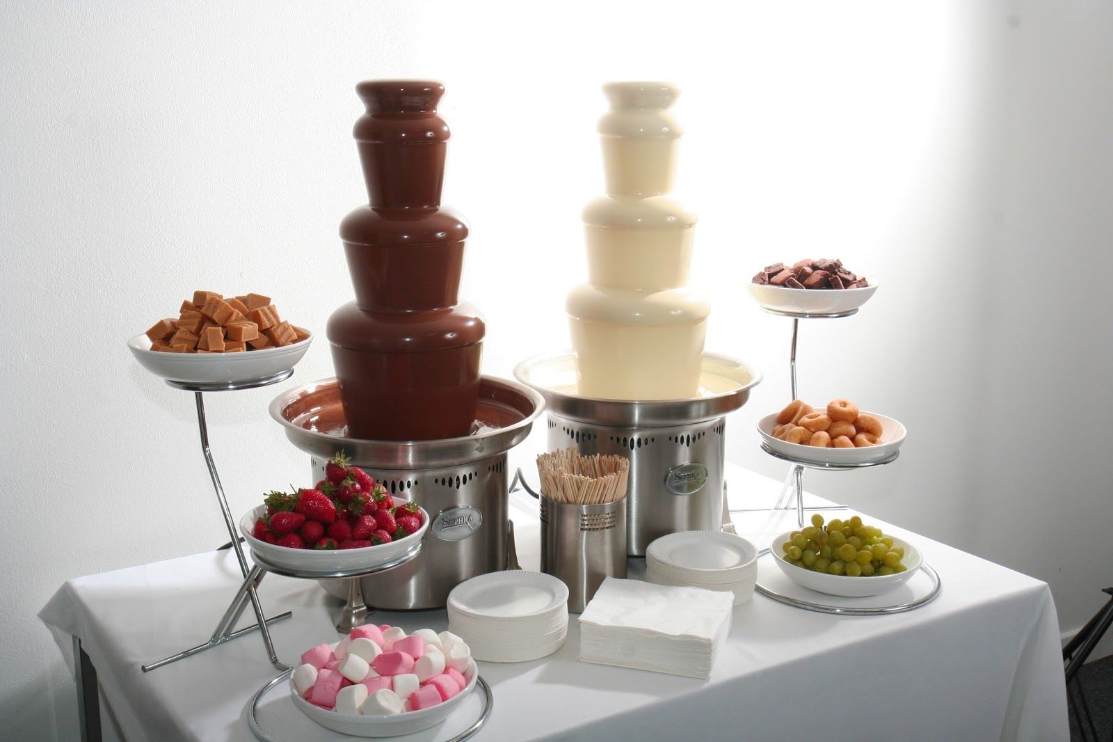 two medium commerical chocolate fountains