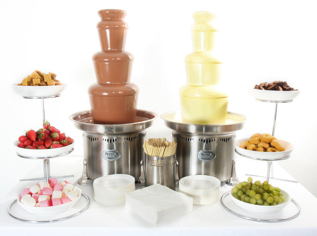two small commercial chocolate fountains